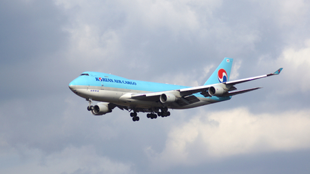 FRANKFURT, GERMANY - FEB 28th, 2015: A Korean Air Boeing 747-4B5ERF MSN 33946 HL7601 freighter approaching runway at Frankfurt International Airport FRA with cloudy sky in the background
