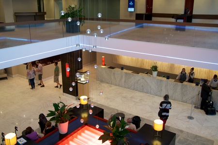 expensive: MAINZ, GERMANY - JUL 8th, 2017: Modern interiors of the lobby at Hilton Mainz Hotel with people waiting in line