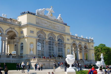 schloss schoenbrunn: VIENNA, AUSTRIA - APR 29th, 2017: The Gloriette houses a cafe and an observation deck which provides panoramic views of the Schonbrunn Palace and gardens, clear sky with some clouds in the background