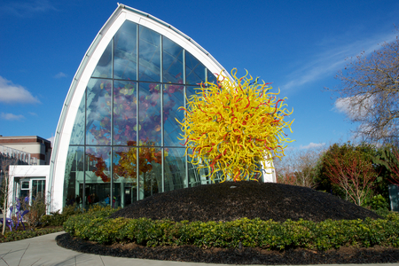 conservatory: SEATTLE, WASHINGTON, USA - JAN 23rd, 2017: Colorful art outside the glass conservatory at the Chihuly Garden and Glass Exhibit