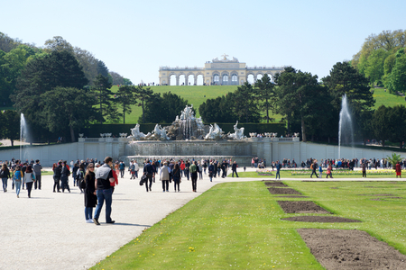 schoenbrunn: VIENNA, AUSTRIA - APR 30th, 2017: Neptune Fountain and Schoenbrunn palace - former imperial summer residence, built and remodelled during reign of Empress Maria Theresa in 1743