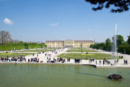gloriette: VIENNA, AUSTRIA - APR 30th, 2017: Schonbrunn Palace with Neptune Fountain in Vienna. Its a former imperial 1441-room Rococo summer residence of Sissi Empress Elisabeth of Austria in modern Wien Schoenbrunn