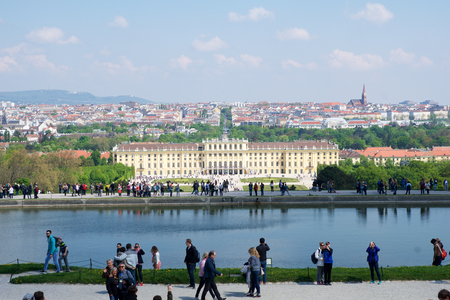 VIENNA, AUSTRIA - APR 30th, 2017: Classic view of famous Schonbrunn Palace, The palace is a former imperial 1441-room Rococo summer residence of Sissi Empress Elisabeth of Austria