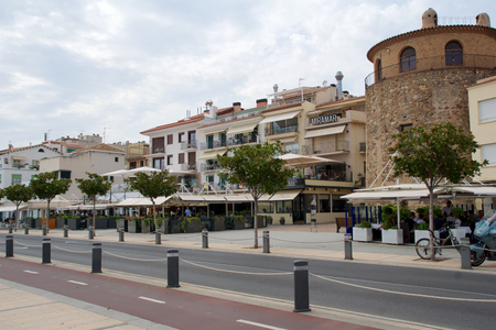 CAMBRILS, SPAIN - AUG 27th, 2017: Museu dHistria de Cambrils - Torre del Port. Seafront with restaurants and pubs