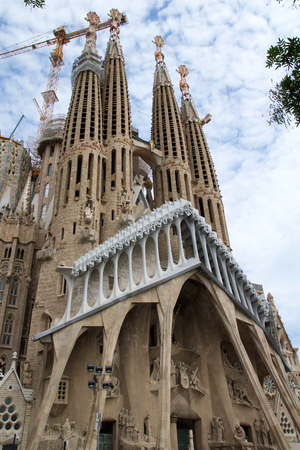 BARCELONA, SPAIN - AUG 30th, 2017: View of main facade of Sagrada Familia Holy Family church designed by Spanish architect Antoni Gaudi Editorial