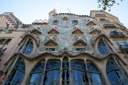 BARCELONA, SPAIN - AUG 30th, 2017: The curving shaped stone facade of Gaudis Casa Batllo, outdoor view on a sunny day