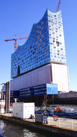 HAMBURG, GERMANY - MARCH 8th, 2014: Landmark Elbphilharmonie - Elbe Philharmonic Hall under construction taken from the opposite riverside of the Elbe
