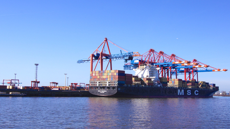 HAMBURG, GERMANY - MARCH 8th, 2014: View of the Eurokai and Burchardkai of the Hamburg harbor. There, the container vessel MSC Rachel is loaded during a clear blue sky day Editorial