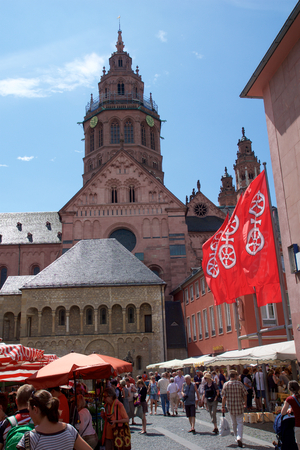 MAINZ, GERMANY - JUL 08th, 2017: Market place with landmark, historic buildings like the dom and people