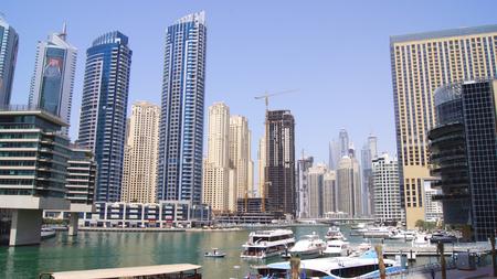 DUBAI, UNITED ARAB EMIRATES - APRIL 2nd, 2014: View on Dubai Marina skyscrapers and the most luxury superyacht marina