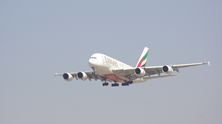 DUBAI, UNITED ARAB EMIRATES - APRIL 1st, 2014: Airbus A380 from Emirates Airlines approaching Dubai Airport DXB, landing of A6-EDU