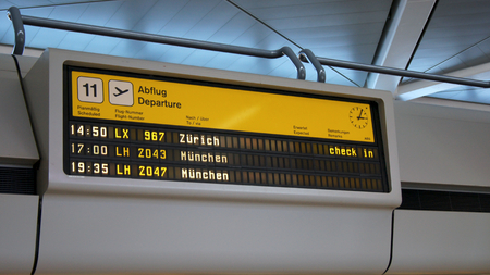 BERLIN, GERMANY - MAR 31st, 2015: A split-flap display at the Berlin Tegel Airport, TXL departure board Editöryel