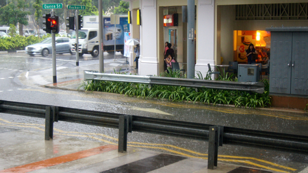 SINGAPORE - APR 2nd 2015: Incredibly strong monsoon rainfall in Asia causing flooding of the street
