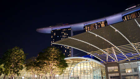 SINGAPORE - APR 2nd 2015: Night view at Marina Bay Sands Resort Hotel. Luxury hotel and most expensive in world standalone casino property is main tourist attraction at city Editorial
