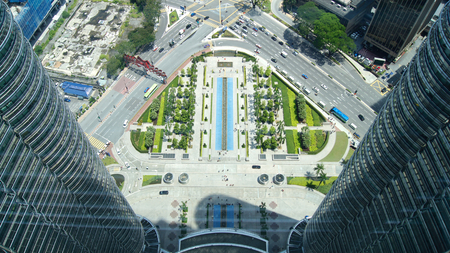 KUALA LUMPUR, MALAYSIA - APR 12th 2015: Amazing view from sky bridge glass panel located 170 meter above street level of Petronas Twin Towers, the famous landmark and highest twin towers in the world