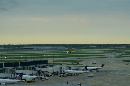 CHICAGO, ILLINOIS, UNITED STATES - MAY 11th, 2018: Several airplanes at the gate at Chicago OHare International Airport in the early morning