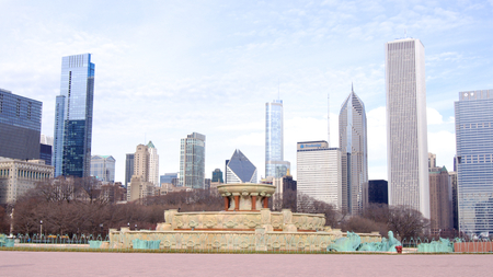 CHICAGO, ILLINOIS, UNITED STATES - DEC 12th, 2015: Buckingham fountain at Grant Park and Chicago downtown skyline