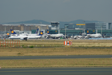 FRANKFURT, GERMANY - JUN 09th, 2017: Aircrafts standing near the terminal 1 at Frankfurt Main airport at the gate or apron