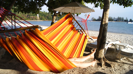 PULAU LANGKAWI, MALAYSIA - APR 5th 2015: Woman relaxing in the hammock at the beach