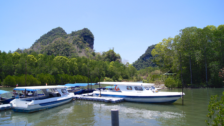 KUAH, LANGKAWI, MALAYSIA - APR 07th, 2015: tourists ride speed boat to visit mangroves at KILIM Geoforest park of Langkawi island