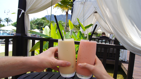 KEDAH, LANGKAWI, MALAYSIA - APR 07th, 2015: Strawberry and Vanilla milk shake in a luxury hotel at the pool Redakční