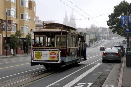 SAN FRANCISCO, CALIFORNIA, UNITED STATES - NOV 25th, 2018: View of the Chestnut Street with tourists riding a cable car Editorial