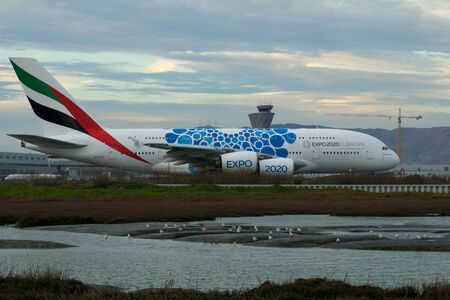 SAN FRANCISCO, CALIFORNIA, UNITED STATES - NOV 27th, 2018: Emirates Airbus A380 airliner with Blue Expo 2020 Dubai taxing at San Francisco Airport SFO. The A380 is currently the largest passenger plane