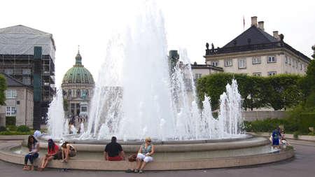 COPENHAGEN, DENMARK - JUL 05th, 2015: Frederiks Church (Marble Church) and Fountain in Amaliehaven garden on a sunny day