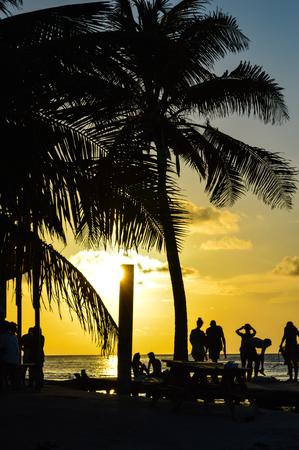 People Enjoying a Caribbean Sunset, Split, Caye Caulker, Belize