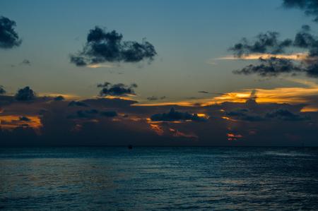 Caribbean Sunset with Cloudscape, Split, Caye Caulker, Belize Stock Photo