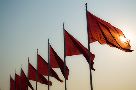 swaying: Chinese Flags Swaying in the Morning Breeze with Sunshine at Tiananmen Square, Beijing, China Stock Photo