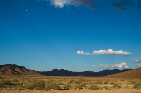 Scenic View of a Desert and Mountain Landscape with Lights and Shadows near Solitaire, Namibia