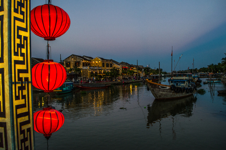 urban idyll: Picturesque Street with Lanterns, River and Boats in the Evening, Hoi An, Vietnam
