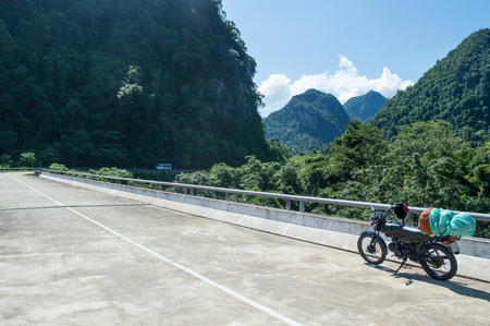 Road and Limestone Formations with Motorcycle, Dong Hoi, Vietnam
