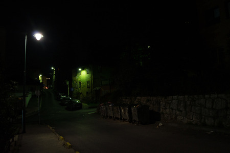 Night Shot of Dark Alley with Trash Bins in Sarajevo, Bosnia and Herzegovina