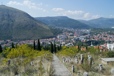 Mostar Old Town and New Town Panorama with Cemetery and Mountain Backdrop, Bosnia and Herzegovina Stock Photo