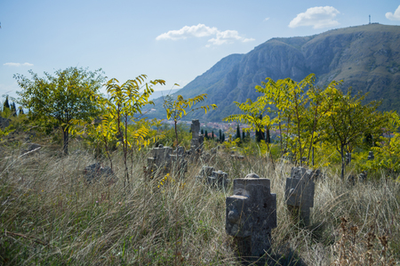 Christian Cemetery with Mountain Backdrop in Mostar, Bosnia and Herzegovina Stock Photo