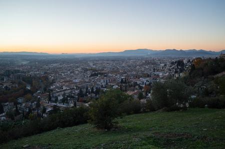 Sunset at Mirador del Barranco del Abogado Lookout with view onto Albayzin in Granada, Spain