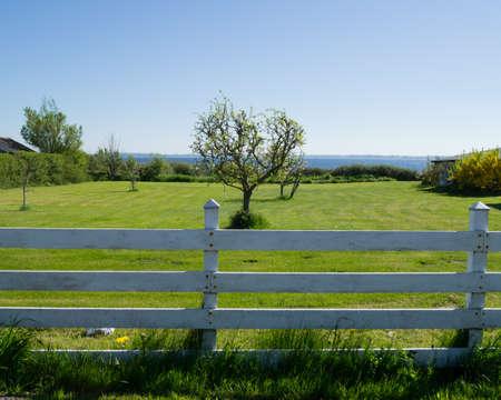 Danish Landscape Seaside Scenery with White Picket Fence