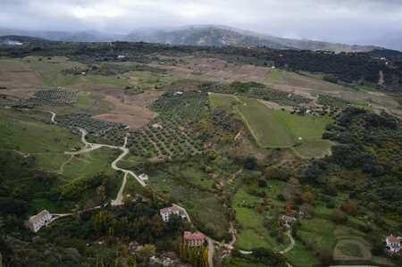 Panorama of Andalusian Landscape with Olive Trees and Fields seen from Ronda, Spain Stock Photo