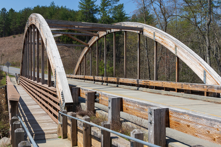 LAKE JAMES STATE PARK, NC, USA-12 APRIL 18: Wooden laminated truss bridge.