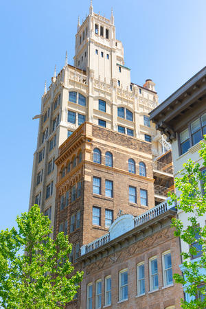The venerable Jackson building in Asheville, NC, USA stands, 140 ft. (15 stories) tall in Pack Square.  The neo-Gothic building was the first skyscraper in western North Carolina.