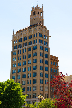ASHEVILLE NC, USA-13 MAY 18: The venerable Jackson building in Asheville stands, 140 ft. (15 stories) tall in Pack Square.  The neo-Gothic building was the first skyscraper in western North Carolina.