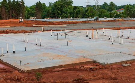 HICKORY, NC, USA-12 MAY 18: Construction begins and concrete pads are poured for a 300 unit apartment complex. Editorial