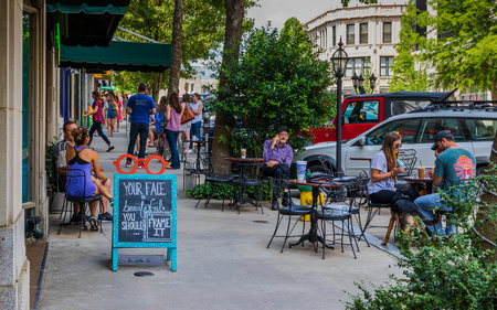 ASHEVILLE, NC, USA-10 JUNE 18:  Dining and socializing on a sunny Sunday on Battery Park Ave. Stock Photo - 103418035