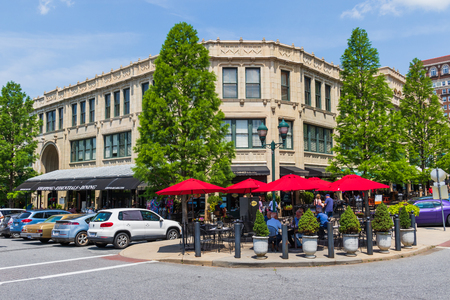 ASHEVILLE, NC, USA-10 JUNE 18:  The corner of the Grove Arcade at Page and Battery Park on an early summer Sunday. Editorial