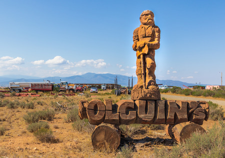TAOS, NM, USA-10 JULY  18: A large woodcarving of a woodsman identifies Olguin