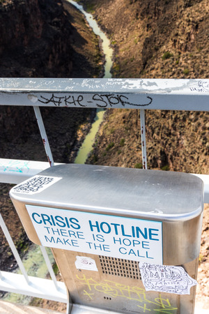 TAOS, NM, USA-6 JULY 18:  The Rio Grande Gorge Bridge, on US 64 south of Taos has, been the site of many suicides, hence the emergency call box shown.