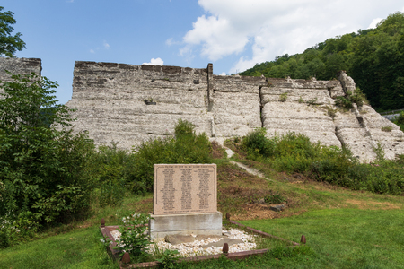 AUSTIN, PA, USA-10 AUGUST 18: A memorial plaque at the remains of a dam which failed soon after construction, in 1911, causing the deaths of 78 people.