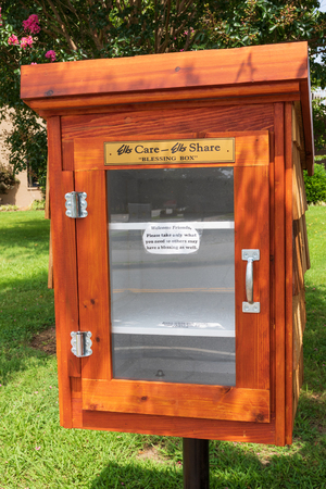 HICKORY, NC, USA-19 AUG. 2018:  A Blessing Box, mounted near sidewalk in front of local Elks Club.